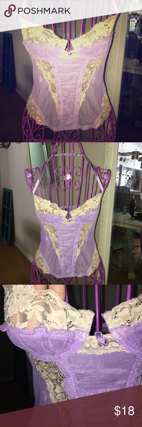 Sheer Lavender Nude Lace Victorian Bustier Absolutely gorgeous Bustier in a lavender color with stunning nude/ cream colored lace accents. Drive him wild in this super sexy and very flirty, good girl gone bad Bustier. Has a sort of Victorian look to it. Excellent pre-loved condition. Labeled size 32. Ideal for a large B or C cup. Feel free to ask any questions and make any offers :] Frederick's of Hollywood Intimates & Sleepwear Bras