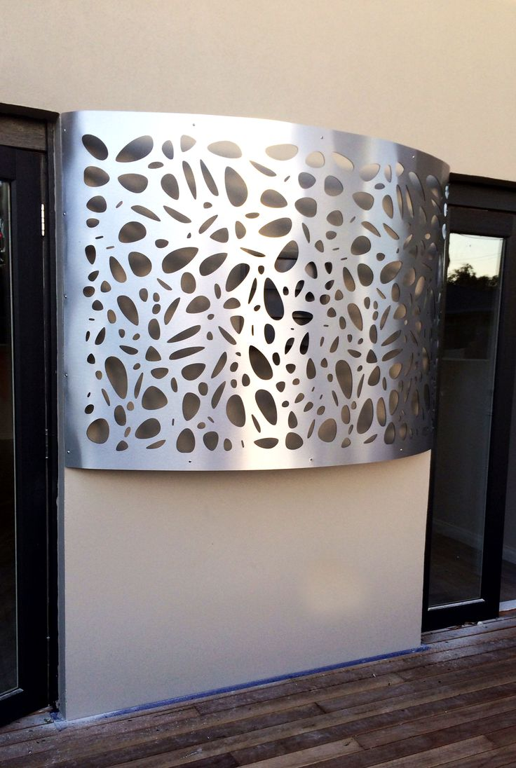 Cover an ugly light feature or make a beautiful lit feature wall using decorative screens over lights as in this aluminium composite 'Cayman' design screen. ~QAQ