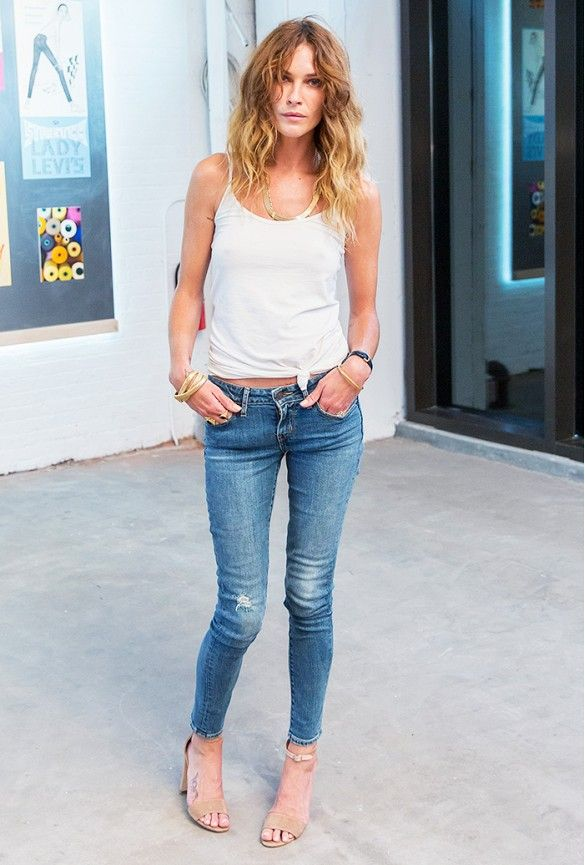 Erin Wasson wears the Levi\u0027s 711 Skinny jean paired with a white tank top  and statement