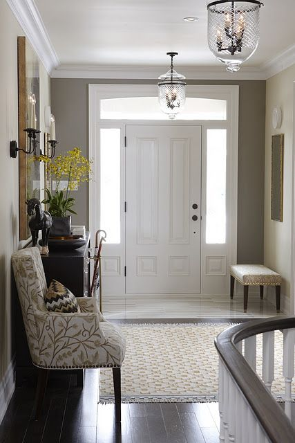 Calm Entry  with dark console & floor, white door & trim, great lights, upholstered chair & bench and marble tile; walls are Elephant Gray (SR58) & Bubbles (SR5) - Sarah Richardson in Sarah's House 4 via Rambling Renovators