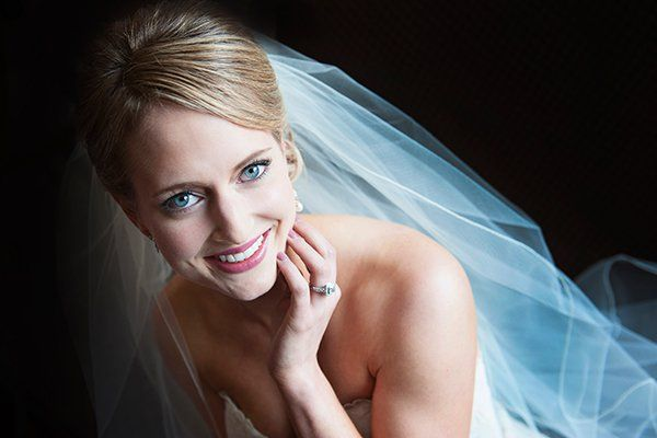 Steel gray shadow enhances this bride's breathtaking baby blues.