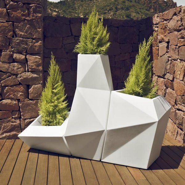 The geometric design of the Faz outdoor planters allow them to be nested together or used singly. The planters have a planting basin molded into the interior of the planter. They are made of rotationally-molded 100% recyclable polyethylene and resistant to extreme heat, cold and UV. Buy $2,500