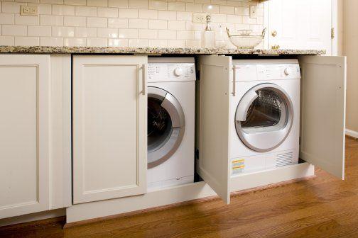 washer/dryer hidden behind cupboard doors