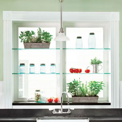 Glass Shelves Above A Kitchen Sink Add Interest And Block The View Of The  Neighbors.