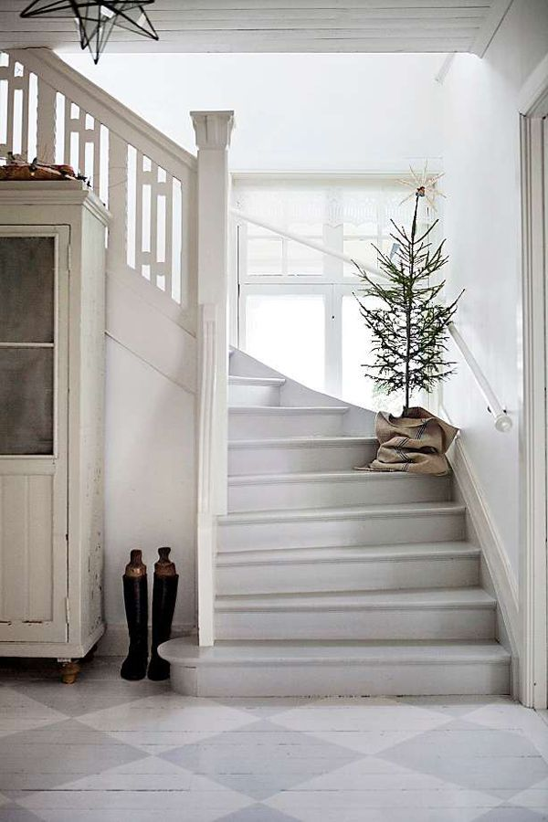 The pale grey of this hallway looks so cool and sophisticated. I love the chequerboard flooring.