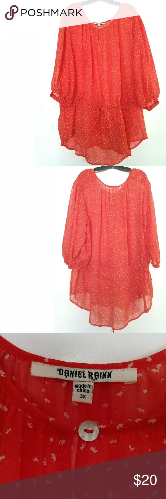 """Daniel Rainn 3X Coral Orange Chiffon Top This Daniel Rainn 3X Coral Orange Chiffon Top is in good used condition. Bust measures 33"""" across laying flat measured from pit to pit so 66"""" around. No stretch. 32"""" long in front; 33.5"""" long in back. Drawstring cinch. Smocking on shoulders. Shell button. ::: Bundle and save! ::: No trades. Daniel Rainn Tops"""