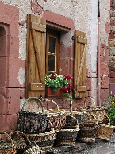 Baskets in Collonges La Rouge France...ooooo, I collect these!  I must go there and see these baskets!