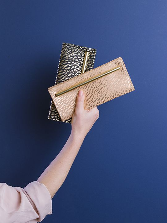 Symmetry collection by Georgie Cummings  Flip wallets with fur print in gold foil
