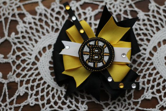 This one of a kind Boston Bruins hair bow is perfect for your little hockey fan. A painted wooden hockey stick and a Bruins feltie are in the