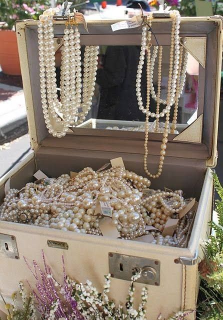 vintage makeup case filled with pearls pearls pearls display idea