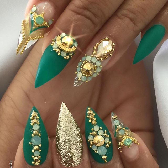 Emerald nails with gold jewels and rhinestones