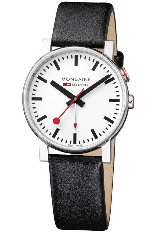 The epitome of watch making comes in the form of the Mondaine Evo Watch with Alarm. A miniature wrist version of the classic Swiss Railways clock designed by Hans Hilfiker in 1944.  The Evo Alarm watch features a Stainless Steel case with a polished finish which compliments perfectly against the black Leather strap. The Clock face then has a white finish with Black index markers and the iconic red second hand. The alarm arrow also features a red top so you can see where it is set at. …