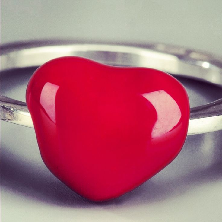 Silver ring from Delfina Delettrez featuring a chunky band and a red enameled heart to the front.