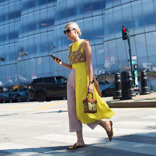 Lemon twist: Sofie Valkiers @sofievalkiers in a Delpozo yellow top cropped on one side, long on the other. Photo by @gastrochic #NYFW #streetstyle #fashion