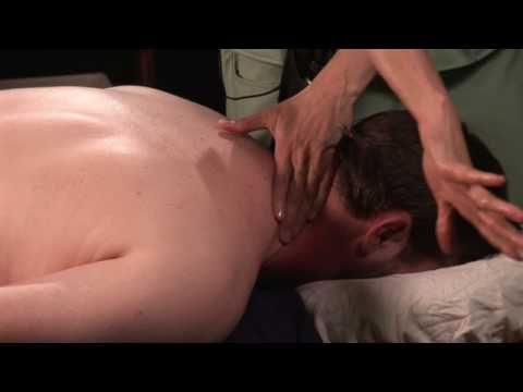 massaging the neck (stiff neck massage)