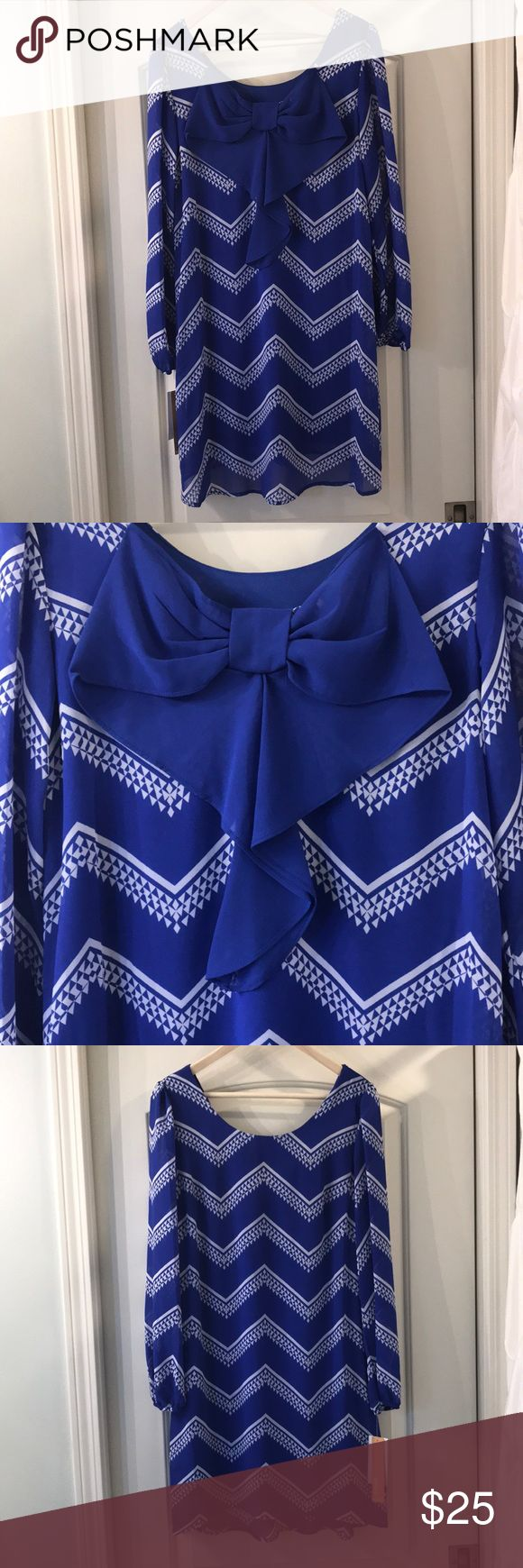 Takara dress M blue white chevron bow  long sleeve NWT Takara size M blue and white Chevron dress with adorable bow on the back. Sleeves are sheer. This dress is perfect for the beach, spring break, honeymoon, or night out. The dress hits mid thigh above the knee. Takara Dresses Midi