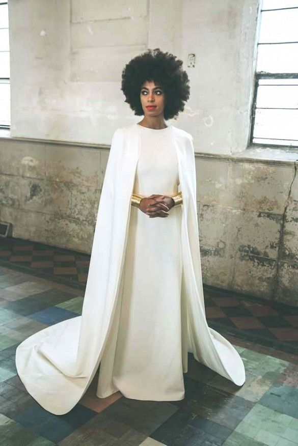 Solange Knowles in her cape-like wedding gown designed by close friend Humberto Leon for Kenzo.