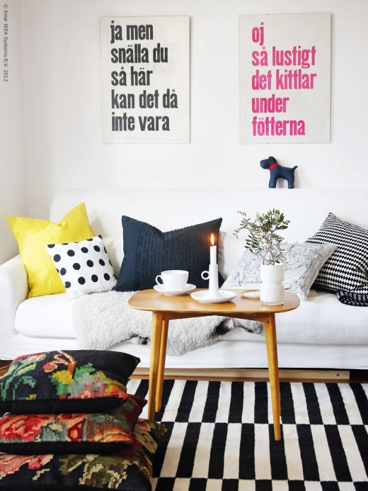 Great mix of pillows + cheerful color palette.