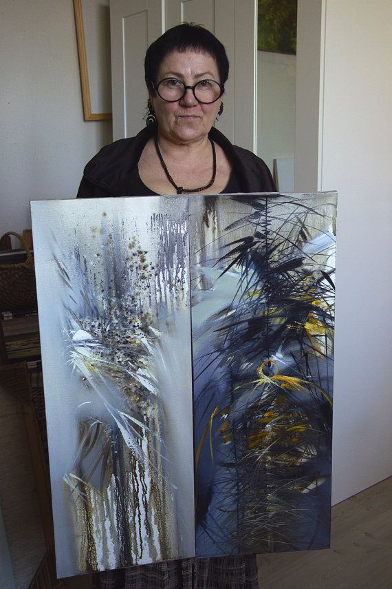 "Artist Tatyana Goodz with her oil diptych paintings ""Bride"" and ""Cage"""