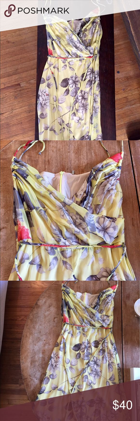 Floral Yellow Dres This is a very light weight dress that is great for going out and looks great with flats or strappy sandals. I wore it with a jean jacket or pashmina depending on where i was going. Minimal wear.  No stains and smoke free home. 🙂 St Vincent Dresses Midi