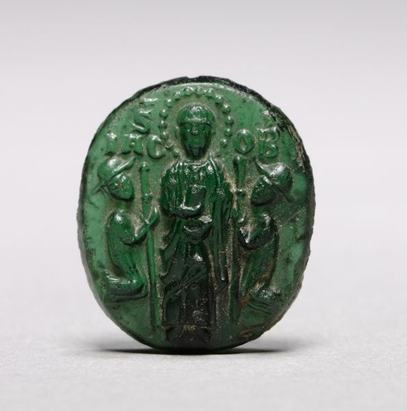 Devotional Badge with Saint James Flanked by Two Kneeling Pilgrims, c. 1200-1250                                                Italy, Venice, 13th century