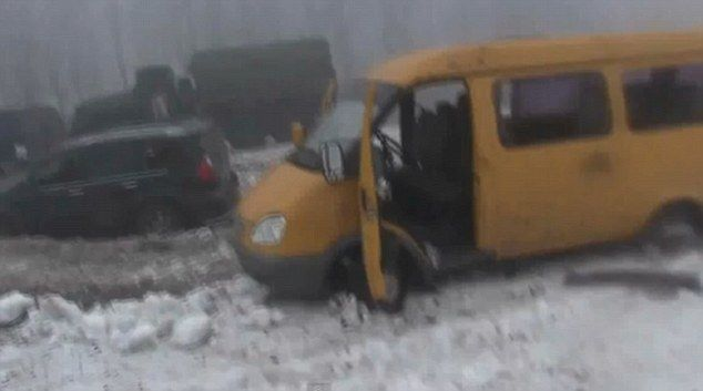 A yellow van lies in ruins amid the carnage in Ukraine's east following the government for...