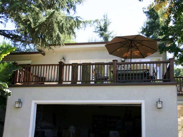 Top 68 ideas about garage upper deck on pinterest for Garage with deck on top