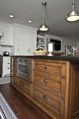 New England Style,Traditional, Classic Kitchen incudes: Island, Crown molding, Fluting, Ornamentation, Trim, Raised Panel Cabinet Doors, Glass Panel Cabinet Doors, Farm Sink, Pot Filler, Oven Hood, Paint & Stained Cabinets, Pendant Lights, Bay Window, Wood Floors