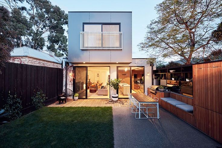Old meets new in this modern extension to an Edwardian House in Melbourne. To better maintain the residence's street facade in its suburban Richmond setting, Archiblox tucked the addition behind the roof line of the existing house. Natural light and a thoughtful use of materials knit everything together.