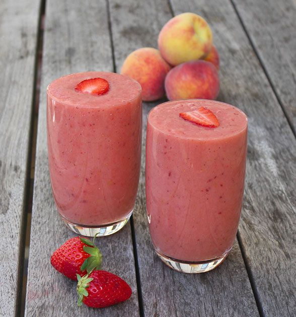 Perfect Peach Smoothie   - 2 frozen ripe bananas - 2 peaches - a dozen strawberries - 1 cup of almond milk - a few ice cubes (optional) Optional – a tablespoon each of ground flaxseeds and chia seeds