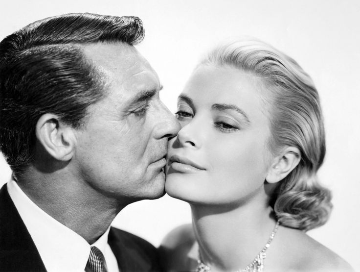 """Portrait of Cary Grant and Grace Kelly in"""" TO CATCH A THIEF """", directed by Alfred Hitchcock, (1955) // When a reformed jewel thief is suspected of returning to his former occupation, he must ferret out the real thief in order to prove his innocence."""