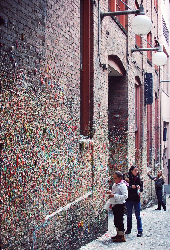 Stick your gum on the Market Theater Gum Wall, a local landmark in downtown Seattle, in Post Alley under Pike Place Market. Similar to Bubblegum Alley in San Luis Obispo, California, the Market Theater Gum Wall is a brick alleyway wall now covered in used chewing gum. Parts of the wall are covered several inches thick, 15 feet high for 50 feet