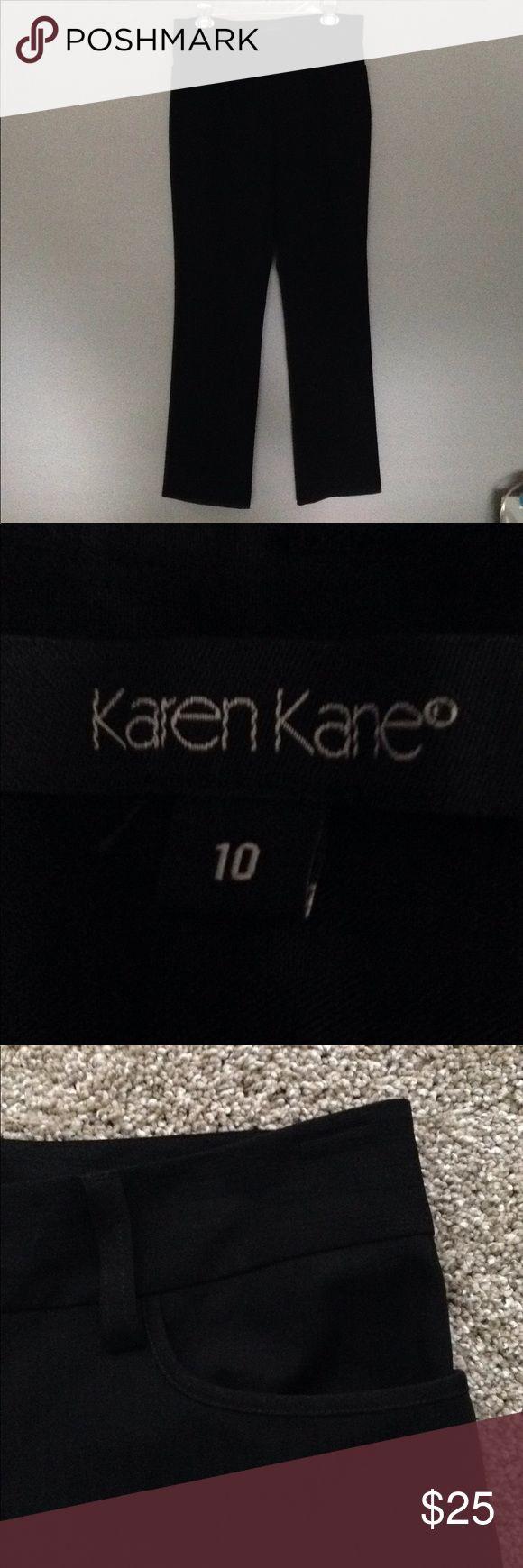 "Karen Kane black striped slacks SZ 10 Beautiful Karen Kane ladies trousers in Size 10 Black on black pinstripe Nice material! 60% polyester 32% rayon and 8% spandex 34"" waist 31"" inseam 2 front pockets Zipper front Never worn New condition Karen Kane Pants Trousers"