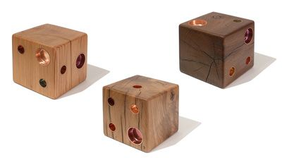 Each die is a unique piece of art - and a candle holder, handcrafted from salvaged wood with copper inlays.