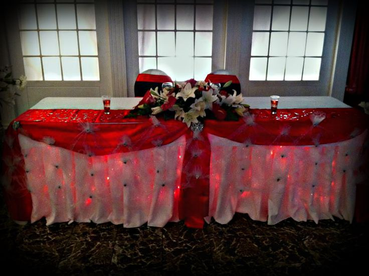 Red Satin head table with red lighting.