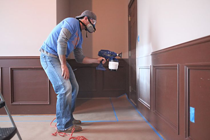 how to spray paint wainscotting ... after seeing this I am sure that this is a job that I will pay a professional to do for us!