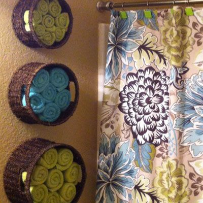 To Do in Master Bathroom: Hang baskets on open wall areas to organize and store towels by size.