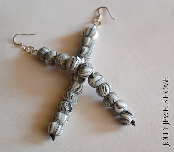 These beaded black, grey and white earrings are handmade from polymer clay (FIMO), which was handshaped into small round beads, combined with black waxed cotton cord and silver tone earwires & findings. Designed in a nice marble style, hanging on your ears just like they would be dancing. The earrings are one of a kind, handcrafted and handshaped, therefore, you will never find a second one like this! Wear unique - be unique! For everyday style, a gift or any special occasion...  Each bea...