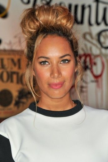 Pretty Messy: Leona Lewis wears a perfectly imperfect top knot that would instantly pull together a sexy LBD look.