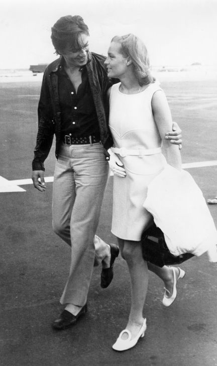 Portrait of Alain Delon welcome Romy Schneider at Nice airport before the set of…