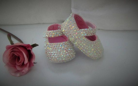 Beautiful Bespoke White Ab Crystal Bling Baby Shoes Available in 0-3, 3-6, 6-12 Months Made with high quality, super sparkly resin glass crystals (not plastic) Perfect for blinging up your baby :-) Please allow a few days for them to be made and shipped. Any Questions please Ask xx