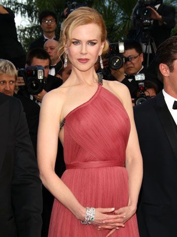 Nicole Kidman attends the premiere for The Paperboy at the Cannes Film Festival at Palais des Festivals on May 24. The actress wears a rose-colored draped Lavin gown on the red carpet.