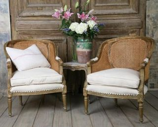 Neat cane back bergere chairs.