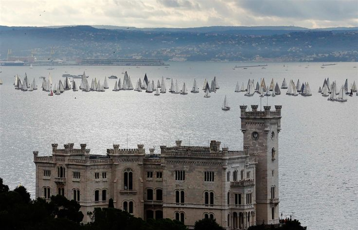 Sailing boats gather at the start of the Barcolana regatta near Miramare castle at Trieste harbor #Italy