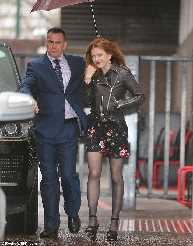 Floral fancy: As Isla later left the ITV studios, she showed off her lovely legs in a pair...