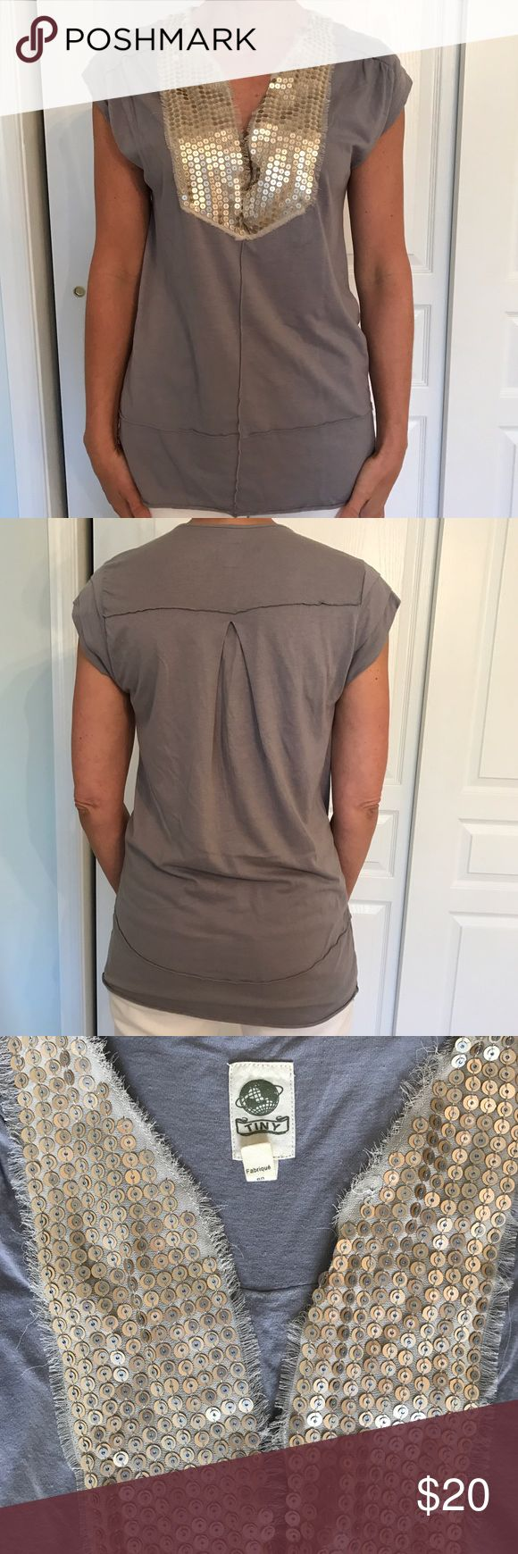 Anthropologie embellished tunic This distinct embellished tunic is a standout. It is a tunic style or longer tee. It is sized small. It is fairly well worn. The color has faded a bit and the one shoulder has a minor tear ( picture included ) Anthropologie Tops Tees - Short Sleeve