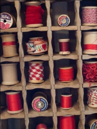 Thread storage, love this showcasing the vintage threads and spools.  I must find a heap in a single colour family--great idea !