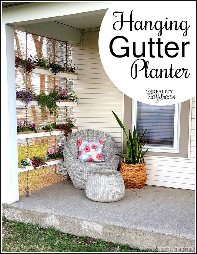 Make a unique vertical hanging planter using gutters and rope! {Reality Daydream}