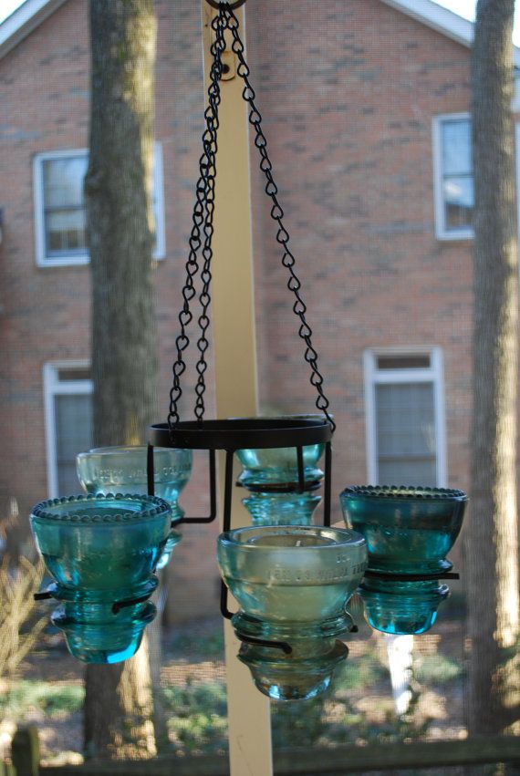 Hanging Candelabra for the Patio (So cute! I had several of these old insulators and sold them in a garage sale or gave them away. Ugh!)