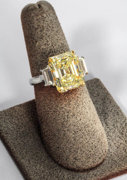 Rare Emerald Cut Fancy Light Yellow VS1 GIA | From a unique collection of vintage engagement rings at http://www.1stdibs.com/jewelry/rings/engagement-rings/